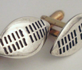 Cufflinks shield design